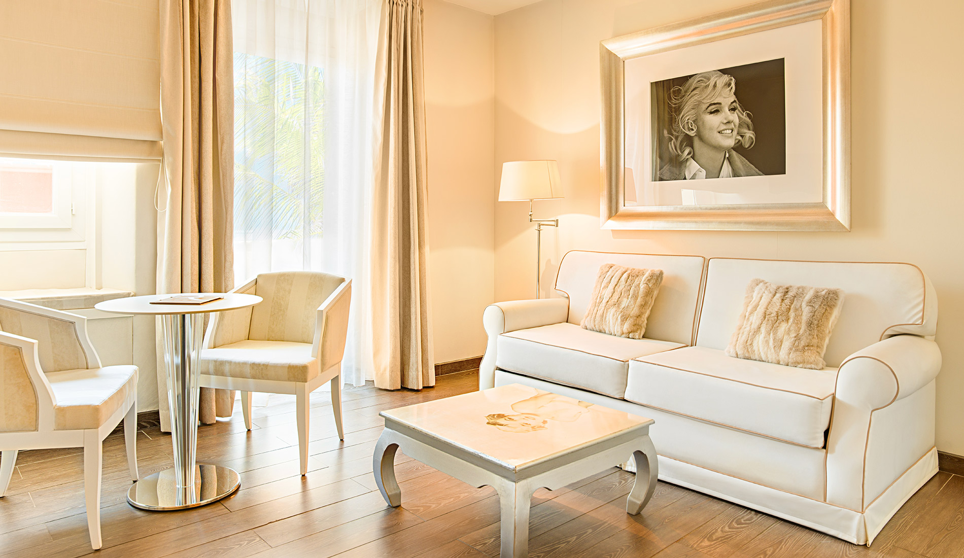 Charming propertyl Hotel Renoir Cannes France 4 star suite with a living room